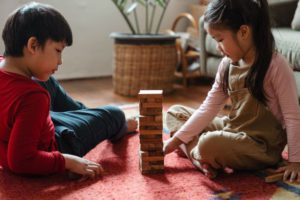 Two Asian children playing Jenga by Ketut Subiyanto via Pexels